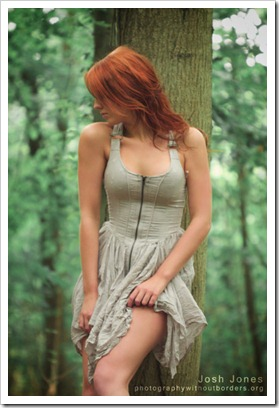 sexy redhead in the forest