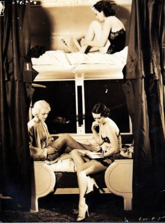 Showgirls-reading-on-a-train-1930